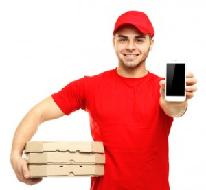 Young man holding pizza and smartphone isolated on white